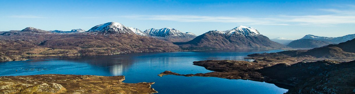 A panoramic of Upper Loch Torridon. Beinn Alligin, Beinn Dearg and Liathach shown in the centre: